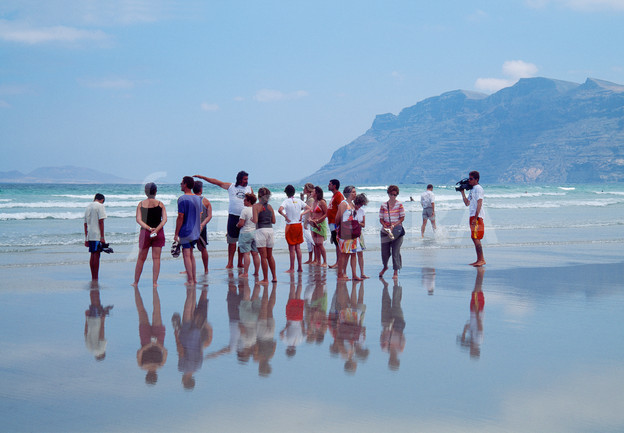 People in Famara beach. Lanzarote